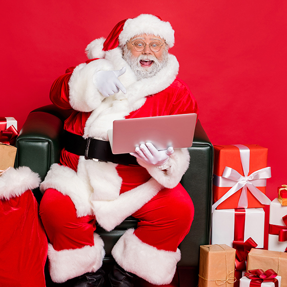Nice cheerful excited glad hard-working fat bearded man checking address wish list isolated on bright vivid shine red backgroun,d