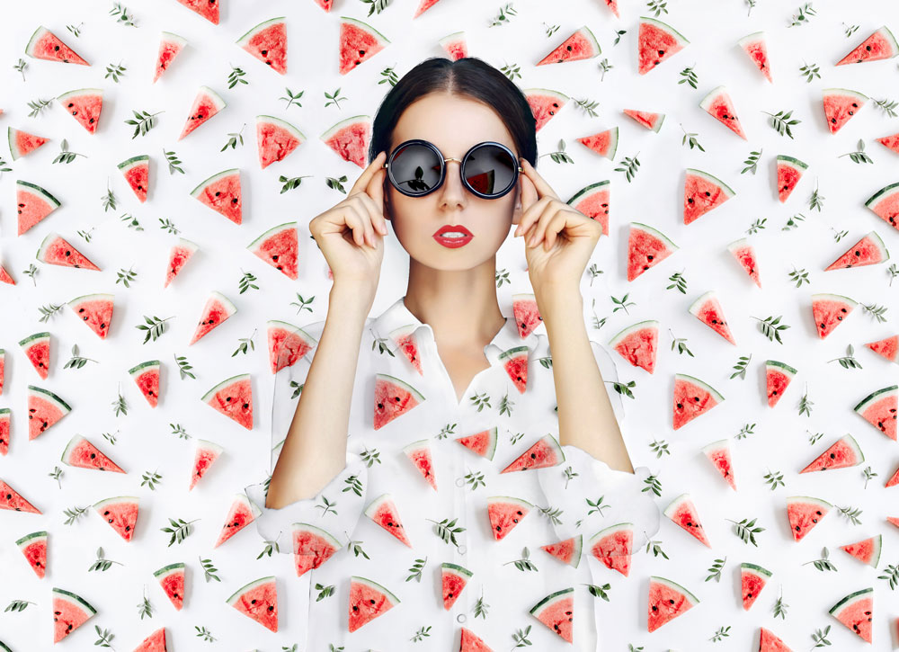 Br24 Composing: cool woman with dark sunglasses, shirt and background with watermelon pattern after Composing