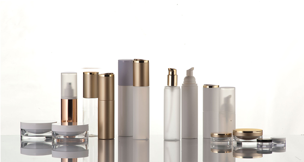 Br24 Product retouch: various cosmetic containers on a glass plate before retouching